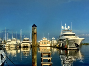 """An early sunset casts a warm light on the """"Next Chapter,"""" a beautiful 130 ft Westport, at the popular Southport (NC) Marina."""